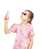 Little pretty girl with toy mobile Royalty Free Stock Photography