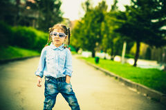Little pretty girl walking on the city street Royalty Free Stock Photo