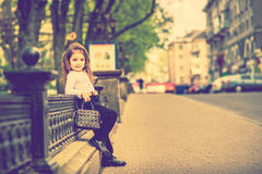Little pretty girl walking on the city street Royalty Free Stock Image
