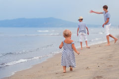 Little pretty girl walking on sea shore Stock Images