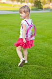 Little pretty girl walks Stock Photography