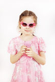 Little pretty girl wearing beautiful pink dress with toy mobile Royalty Free Stock Image