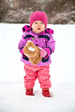 Little pretty girl in winter with the toy Royalty Free Stock Photo