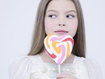 Free Little Pretty Girl With Big Candy Stock Photos - 172144383