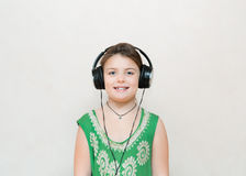 Little pretty happy stylish girl enjoying her music record track Royalty Free Stock Image