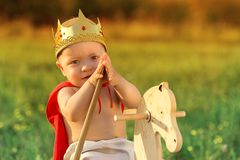 Little Prince with a crown on the head stock image