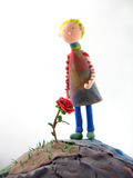 Little prince and his rose Stock Images