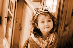 Little princess. In nice clothes is looking very happy Royalty Free Stock Photography