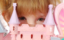 Little princess. Little girl princess and her castle royalty free stock photography