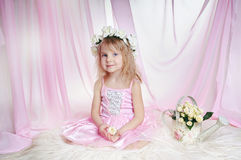 A Little princess. A girl looks like a princess in pink clothes stock image
