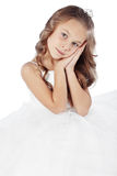 Little princess. Portrait of a little princess girl wearing wedding dress isolated on white background stock photo