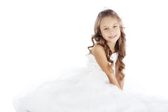 Little princess. Portrait of a little princess girl wearing wedding dress isolated on white background royalty free stock image