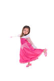 Little Princess. Cute little girl dress in a pink princess costume standing on one leg, in a graceful movement. Isolated on white Royalty Free Stock Photos