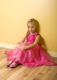 Little Princess. Adorable little girl sitting in pink princess dress royalty free stock image