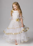 Little princess. Beautiful little girl in princess dress with long hair barefoot stand on grey background Stock Photography