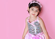 Little princess. Little girl dressed as a princess-against pink backdrop stock images