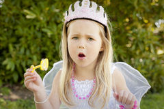 Little princess blowing bubbles Royalty Free Stock Images