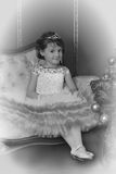 Little princess  at the Christmas tree, monochrome vintage photo Royalty Free Stock Photo