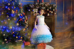Little princess  at the Christmas tree Royalty Free Stock Photo