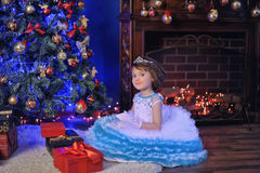 Little princess  at the Christmas tree Royalty Free Stock Images