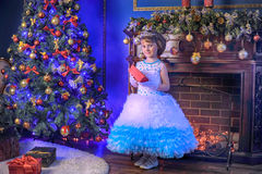 Little princess  at the Christmas tree Royalty Free Stock Image