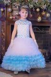 Little princess  at the Christmas tree Stock Image