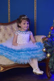 Little princess  at the Christmas tree Stock Photography