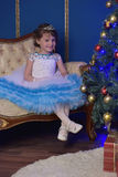 Little princess  at the Christmas tree Royalty Free Stock Photos