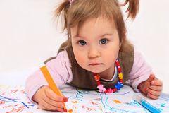 Little princess drawing. Little girl is drawing with color pencils on white background Royalty Free Stock Photo