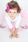 Little princess girl sitting on the floor Royalty Free Stock Photos