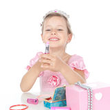 Little princess with a lipstick and a crown Royalty Free Stock Image