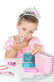Little princess with a lipstick and crown Stock Photo