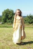 Little princess on a meadow Stock Photos