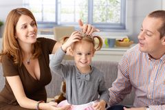 Little princess and parents at home Royalty Free Stock Images