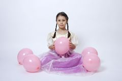 Little princess with pink balloons Stock Photography
