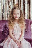 Little princess. Pretty girl with golden crown. Royalty Free Stock Photos