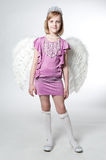 Little princess in purple dress and wings Royalty Free Stock Image