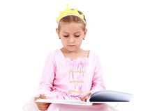 Little princess reading Stock Image