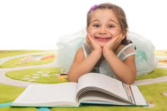 Little Princess Reading Fairytale. Little adorable girl with princess costume reads fairytale book Royalty Free Stock Image