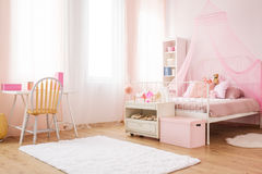 Little princess room with bed. Pink little princess room with canopy bed, desk and chair royalty free stock photography