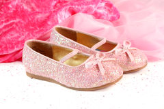 Little princess shoes. Little girl's pink sparkly make belief princess shoes stock images