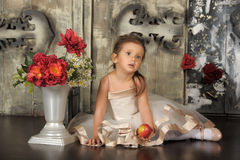 Little princess in a smart beige dress Royalty Free Stock Photos