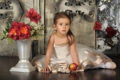 Little princess in a smart beige dress Royalty Free Stock Image