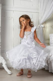 Little princess in a smart white dress Stock Images