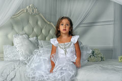 Little princess in a smart white dress Royalty Free Stock Photos