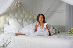 Little princess in a smart white dress Stock Photos
