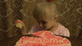 Little Princess Taste a  Big Piece of Cake. 4K, UHD, Ultra HD resolution stock video