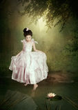 Little princess and water lily royalty free stock photos