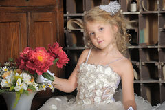 Little princess in white dress and red flowers