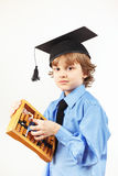 Little professor in academic hat with old abacus on white background Stock Photography